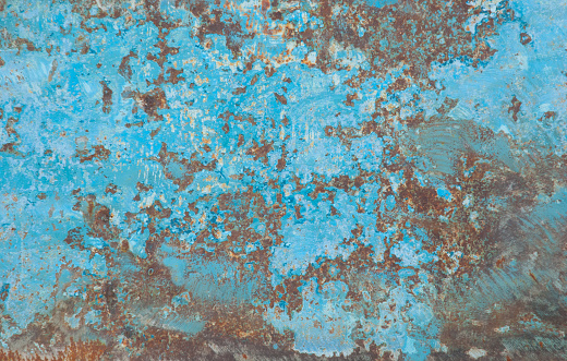 Old iron sheet with traces of rust. Blue paint with cracks