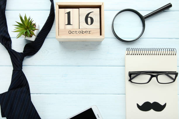 Sheet of paper with glasses, tie and wooden calendar. Boss day concept Sheet of paper with glasses, tie and wooden calendar. Boss day concept boss's day stock pictures, royalty-free photos & images