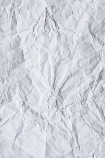 sheet of white crumpled paper - seamless repeatable texture stock photo