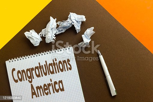 istock sheet paper, notebook with Congratulations America, vote concept 1215003840