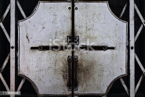 istock Sheet steel plate of scissor security gates-S.Padilla Street. Binondo Chinatown-Manila-Pilippines-1005 1128555462