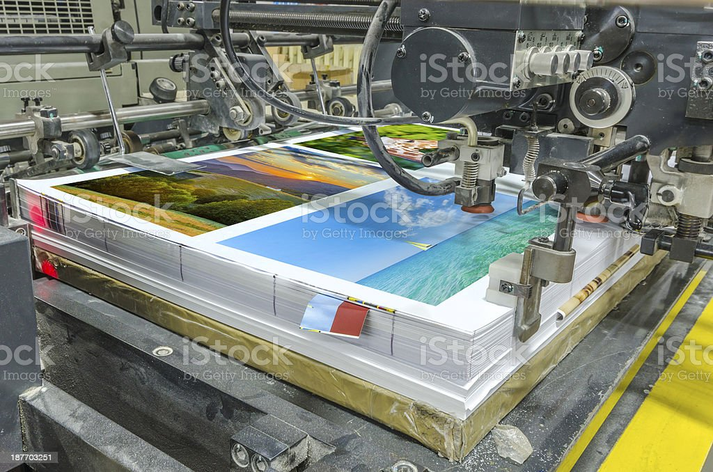 sheetfed paper feeder unit. Poster printing stock photo