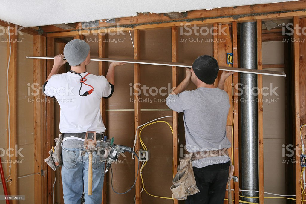 Sheetrock Hanger Team royalty-free stock photo