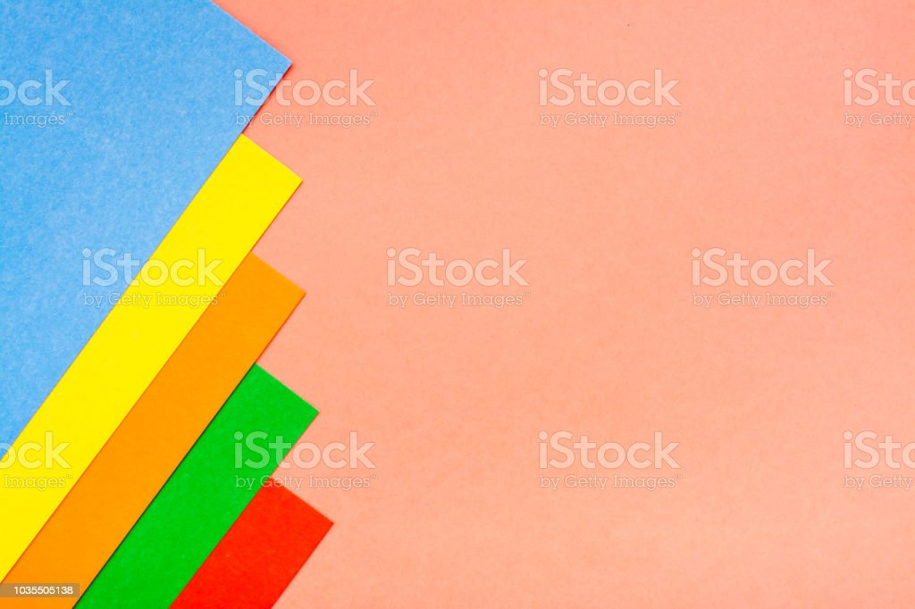 Sheets Of Colored Cardboard Lie In A Row On A Red Background Stock ...