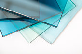 istock Sheets of Factory manufacturing tempered clear float glass panels cut to size 1216789812