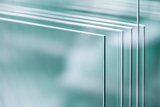 Sheets of glass closely placed together Unprocessed glass panel in glass factory. glass material stock pictures, royalty-free photos & images