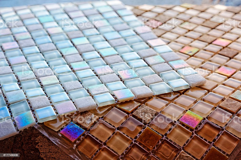 Sheets of glass tile mosaic. Close-up textute. Selective focus. stock photo