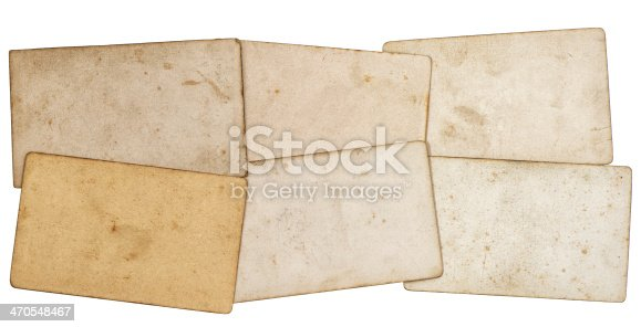 1129542015 istock photo sheets of old grungy paper isolated on white 470548467