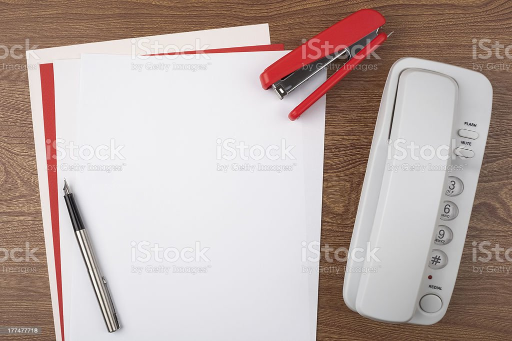 Sheets of paper and office accessories on wooden texture royalty-free stock photo