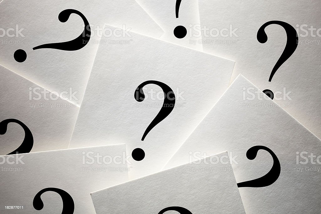 Sheets of paper with question mark royalty-free stock photo