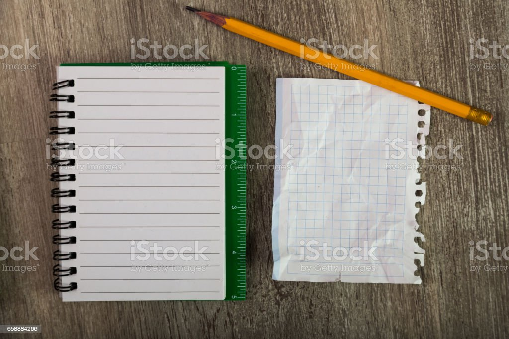 sheets with notebooks and writing utensils stock photo