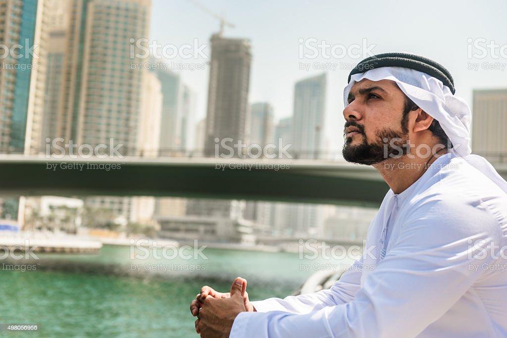sheik pensive on the Dubai Marina city stock photo