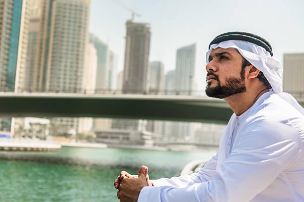 sheik pensive on the dubai marina city - styles stock photos and pictures
