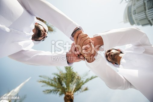 istock sheikh doing a deal in UAE 465118954
