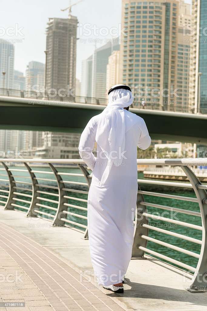 sheikh talking and walking togetherness on the city stock photo