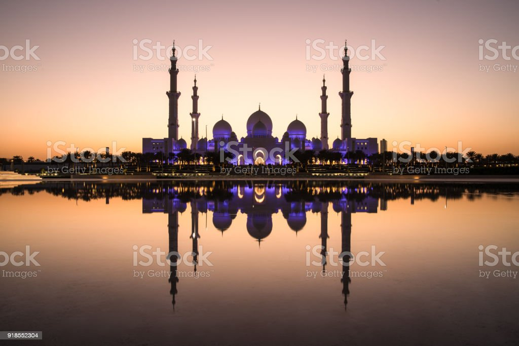 Sheikh Zayed Grand Mosque and it's perfect reflection. stock photo