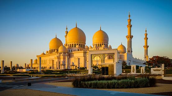 The beautiful Sheikh Zayed Mosque in Abu Dhabi, UAE in warm evening light