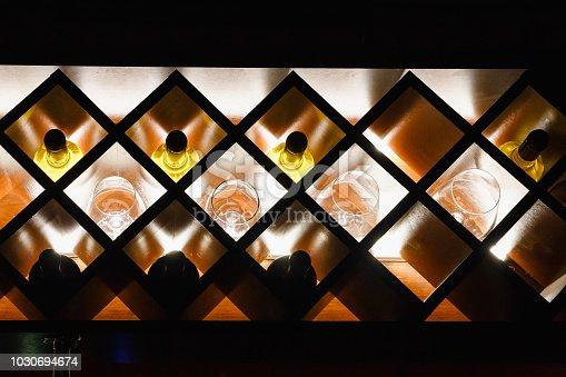 shelf for storing wine bottles with illumination