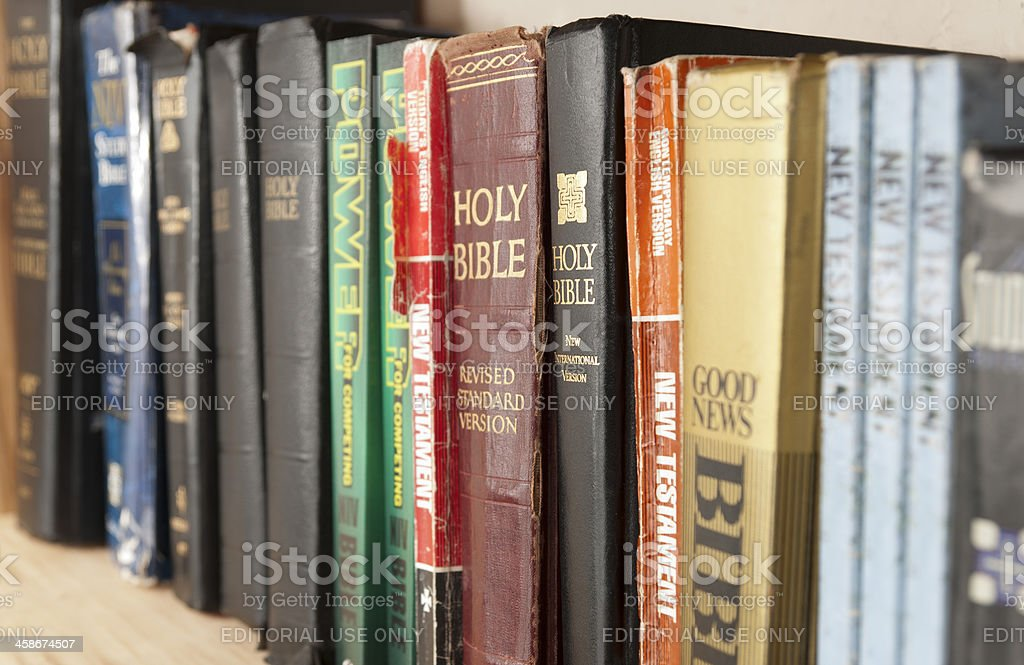 Shelf Full of Bible Translations stock photo