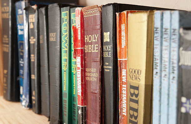 Shelf Full of Bible Translations stock photo