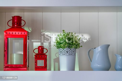Knick knack arrangement on a shelf set in a country house