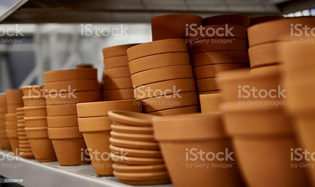 Shelf of Clay Pots stock photo