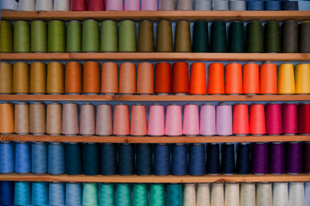 Shelf of colored sewing thread (rainbow colors) - Photo