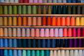 Shelf of colored sewing thread (rainbow colors)