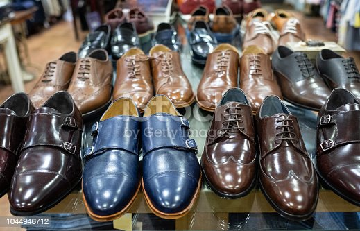 shelf of pairs of blue and brown shoes