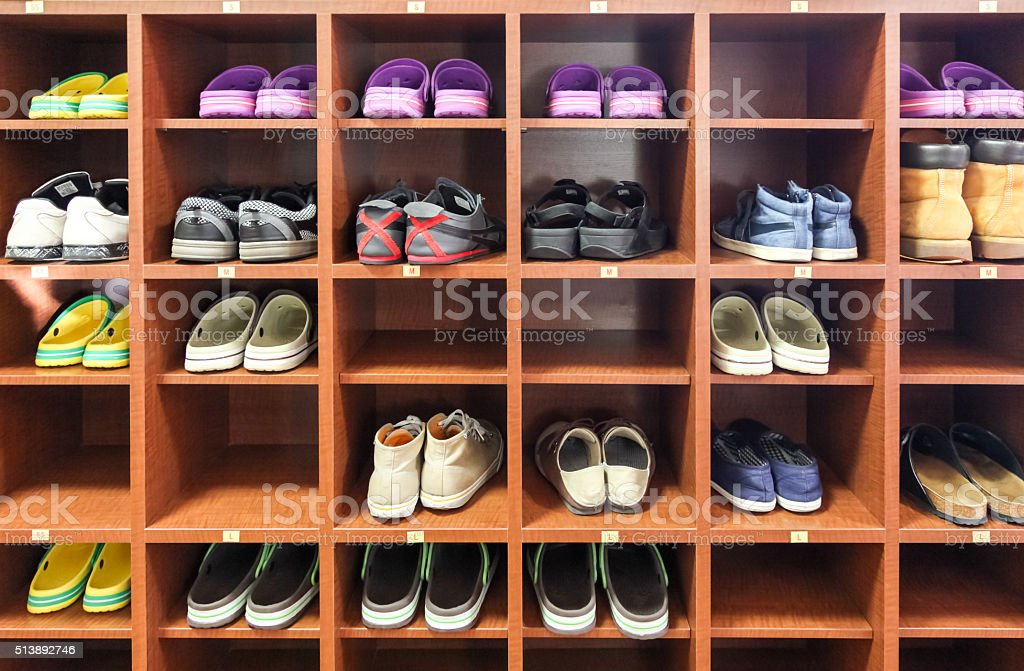 shelf of shoes., old shoe on rack stock photo