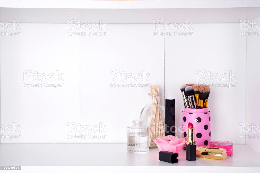 Shelf with cosmetics in bathroom on a white bathroom shelf stock photo