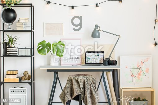 istock Shelf with creative painting 834452890