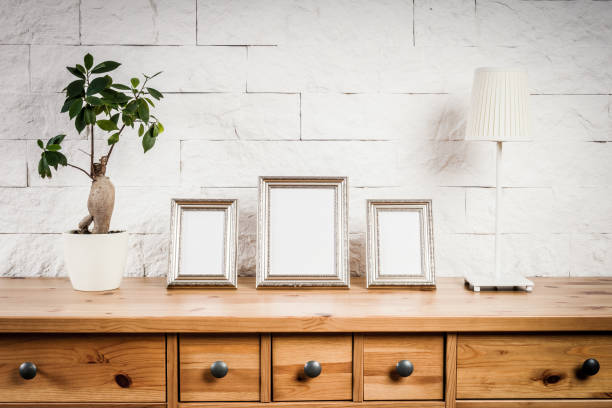 shelf with frames and flower