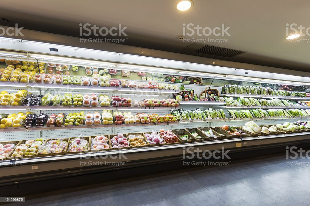 Shelf with fruits in supermarket stock photo