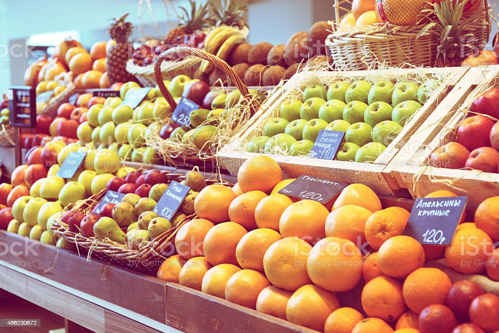 Shelf with fruits, toned stock photo