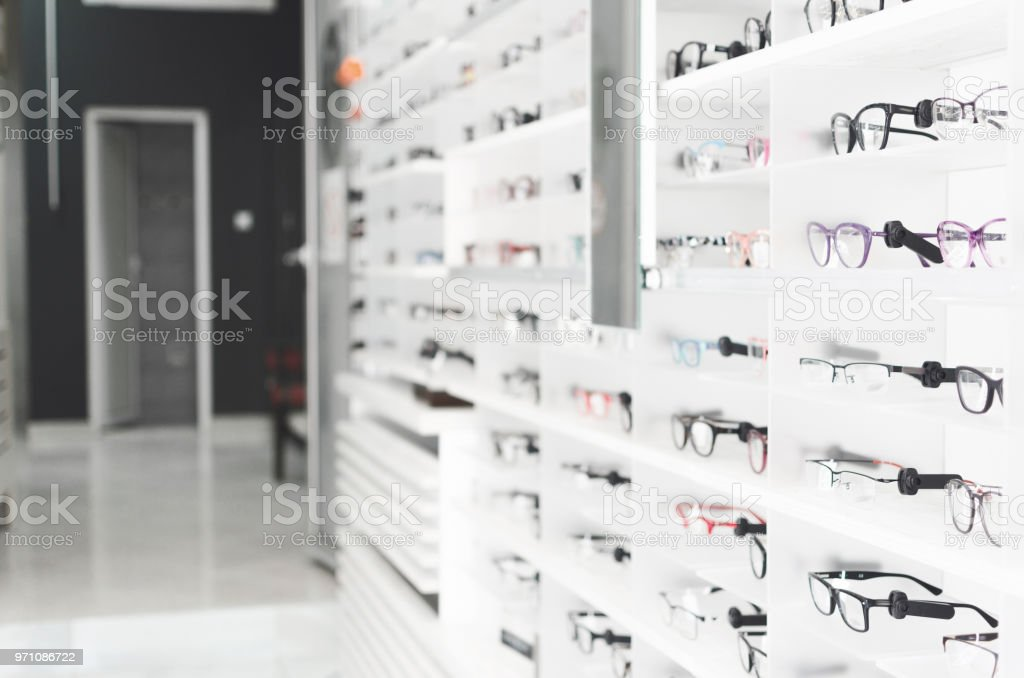 shelf with glasses in the shop stock photo