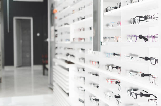 shelf with glasses in the shop - optometrist stock pictures, royalty-free photos & images