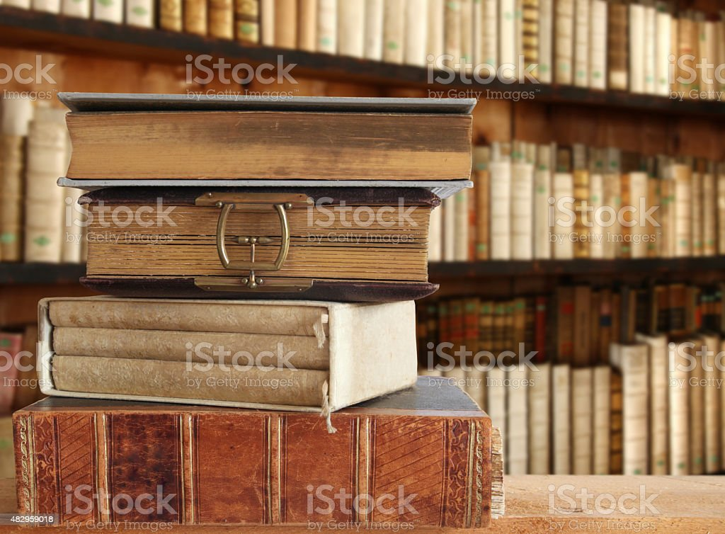 shelf with old books stock photo