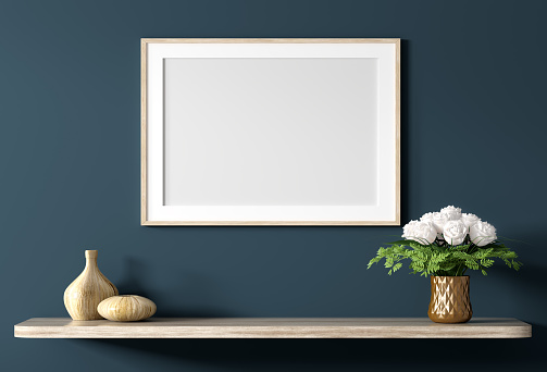 Blank canvas poster above wooden shelf with bouquet of flowers over blue wall, interior decoration background 3d rendering