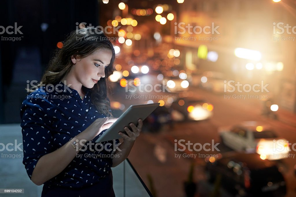 She'll be online all night long stock photo
