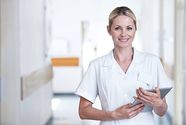 she'll be taking care of you - female nurse stock photos and pictures