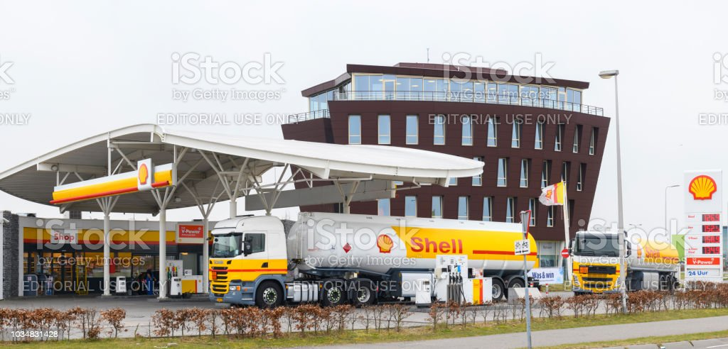 Shell Fuel Delivery Trucks Supplying A Gas Station With Fuel Stock Photo Download Image Now Istock