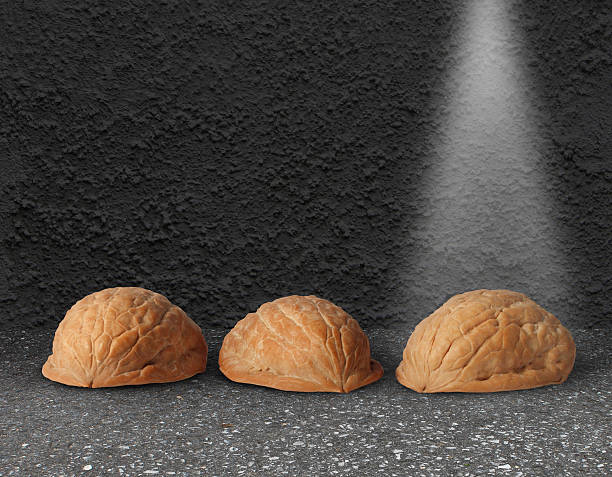 Shell Game Shell game with three walnut shells on city street pavement with a light shinning on the winning choice as a business concept of choosing the right investment with the assistance of professional guidance. shell game stock pictures, royalty-free photos & images