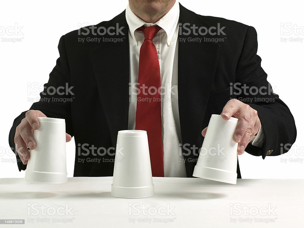Shell game scam stock photo