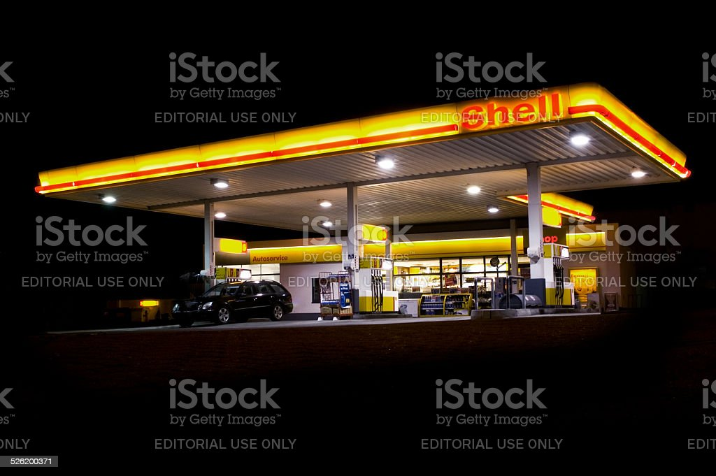 Shell gas station at midnight stock photo