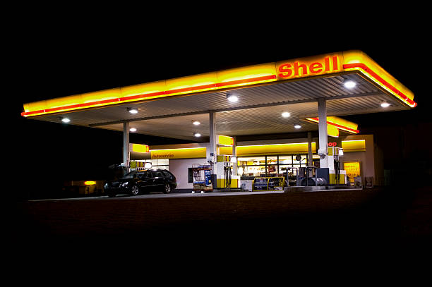 shell gas station at midnight - animal shell stock pictures, royalty-free photos & images