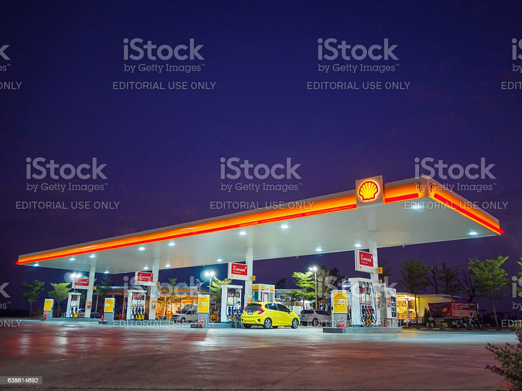 Shell gas station blue sky background during sunset. stock photo