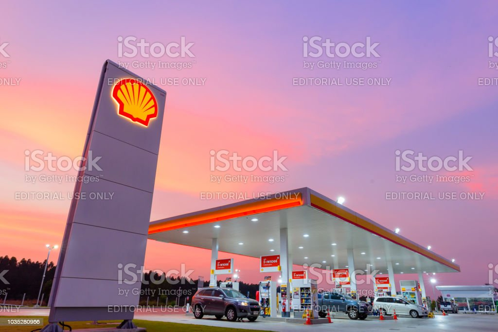 Shell gas station blue sky background during sunset. Royal Dutch Shell sold its Australian Shell retail operations to Dutch company Vitol in 2014 stock photo