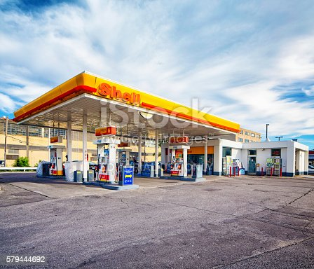 Monytreal, Canada - July 24, 2016: Shell gas station in Montreal Canada with ice box, propane and car wash. Customers are visible.