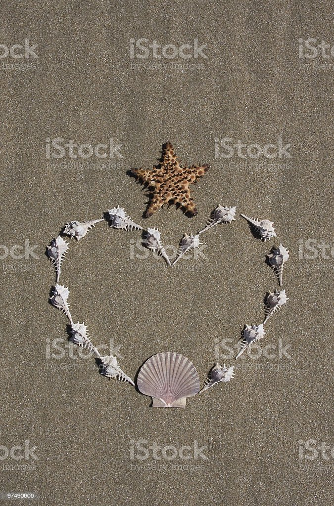 Shell Heart with Starfish Crown on Beach royalty-free stock photo